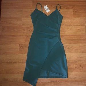 Teal a-symmetrical body-con dress